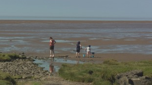 A family enjoys the beach at Powfoot near Annan