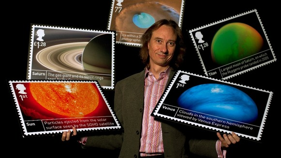 Dr Stuart Clarke, astronomer, with the stamps.