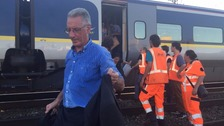 Passengers evacuate a train in France following power outage after a fire broke out.