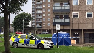 Three people found dead after woman was heard screaming for help at block of flats