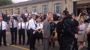 Prince Charles inspecting police and navy personnel in Devonport