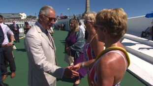 Prince Charles in Penzance meeting swimmers during the heatwave