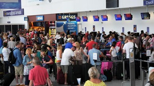 Passengers check in at Newcastle Airport ahead of their summer holidays