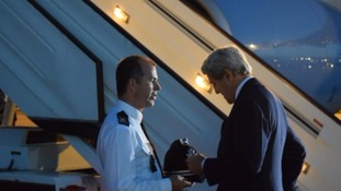 Supt Glenn Maleary presented John Kerry with the helmet.