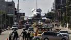 Space shuttle Endeavour is transported on Manchester Avenue in Los Angeles, California.