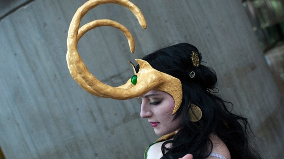 Dressed as the comic book character Loki, fan Alina Vukul, adjusts her costume during Comic Con at the Jacob Javitz Center