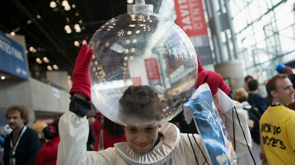 Fan Borges, dressed as Captain Olimar of the Pikmin video game series, adjust his helmet to his costume during Comic Con.