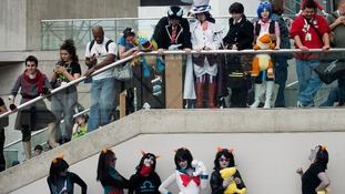 Fans take part in a costume contest during the convention.