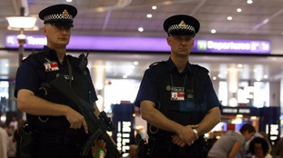 File: Police at Manchester Airport