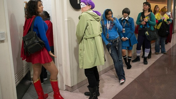 Comic Con-goers queue up to use the restroom during Comic Con at the Jacob Javitz Center in New York.