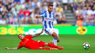 Huddersfield Town's Tommy Smith (right) is tackled by Liverpool's Alberto Moreno