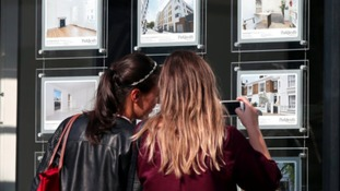 women looking at houses