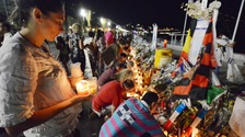 People leave tributes to the dead and wounded after the attack
