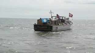Lovingly restored Broads cruiser given Royal Navy escort out of Great Yarmouth