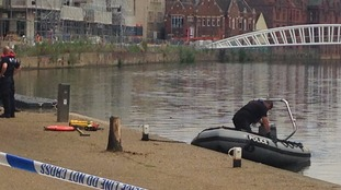 Police have warned about the dangers of open water after finding a woman's body in Bedford.