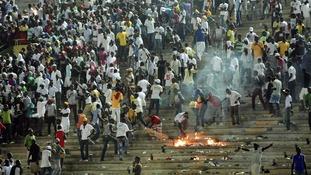 Senegalese football fans light fires at the Leopold Sedar Senghor stadium in Dakar.