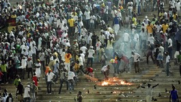 Senegalese football fans light fires at the Leopold Sedar Senghor stadium in Dakar.