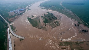 At least 87 dead and tens of thousands forced from their homes after flooding in China
