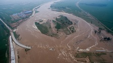 At least 24 dead and tens of thousands evacuated after China flooding