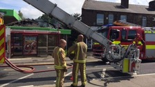 Fire crews damping down after fire on roof of petrol station at Birchencliffe