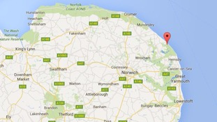 Two swimmers pulled from the sea and being treated by paramedics on Norfolk beach