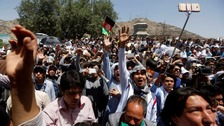 At least 61 dead after Kabul protest suicide attack