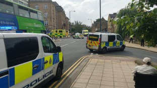Police at the scene of a stabbing in Shipley town centre