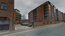 Two people have been arrested after a woman was raped in Manchester city centre.