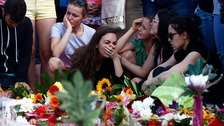People mourn the victims of the attack.