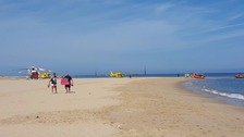 A 54-year-old man died after gettin g caught up in tide on a Norfolk beach