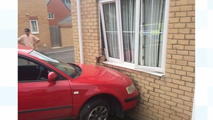 Police are searching for a red Volkswagen Passat that crashed into a house yesterday afternoon