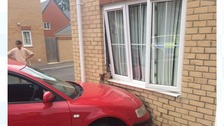 Police search underway after car crashes into house