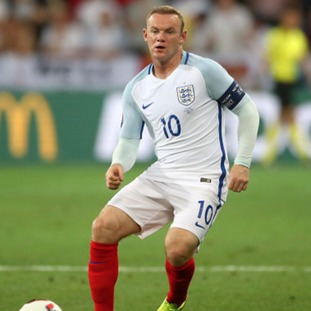 Rooney in action for England.