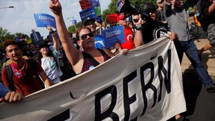 Protesters march against presumptive Democratic nominee Hillary Clinton