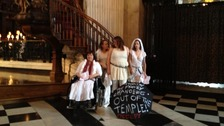 Four women chained themselves to the pulpit.