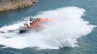 Lifeboat launches into the sea