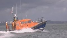 Poole lifeboats rescue person in water