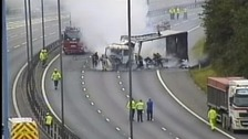 A lorry is on fire on the M6, blocking the carriageway both ways.