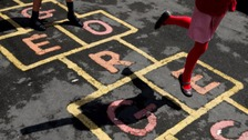 Children playing hopscotch