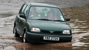 Car in puddle