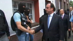 President Hollande meets masked members of the police.