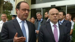 President Hollande (left) at the scene of the attack.