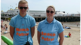 Lifeguards Chris Simpson and Sian Rowlen helped to save the woman who was found lying head first in the sea