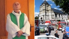 Priest killer was wearing police tag at time of attack
