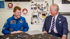 Astronaut Tim Peake and Prince Charles share a joke.