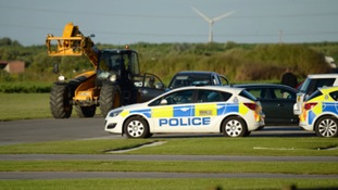 .Police at Breighton airport near Selby following the crash