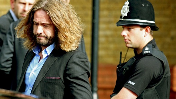 Justin Lee Collins leaves St Albans Crown Court after being found guilty of harassing his former partner, Anna Larke.