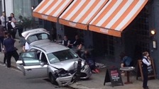 Unmarked police car hits restaurant diners