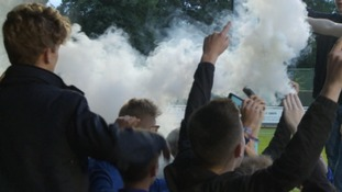 Smoke devices thrown onto pitch disrupt Exeter City game