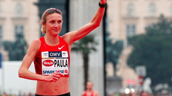 Marathon world record-holder Paula Radcliffe reacts after crossing the finish line at the Vienna city half marathon